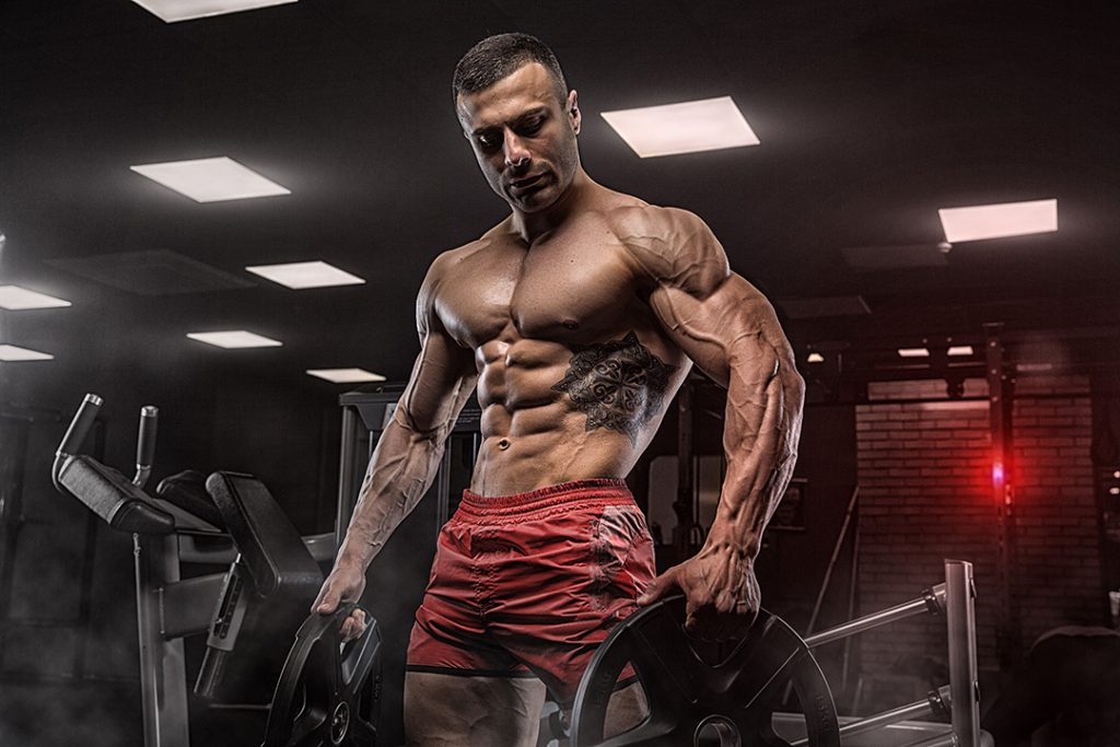muscle athlete holding weights