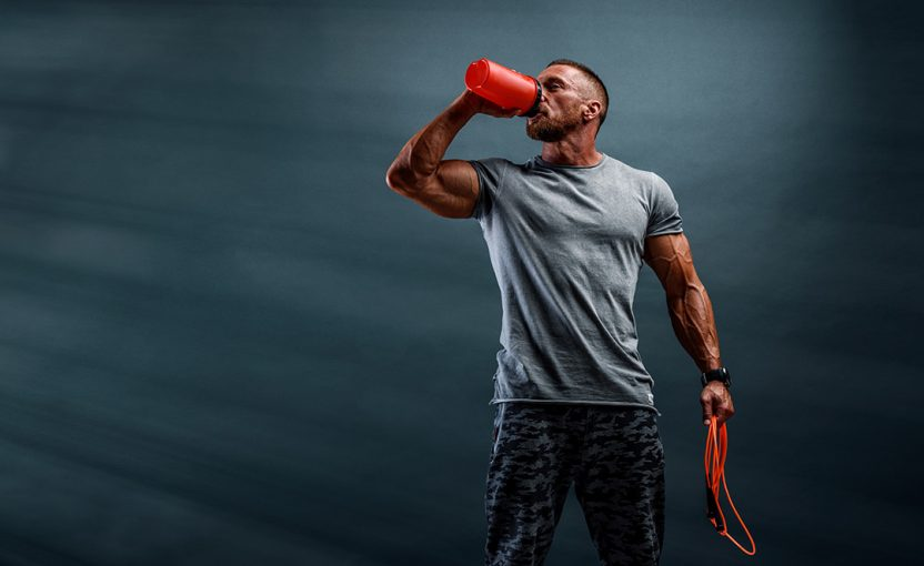man drinking pre workout